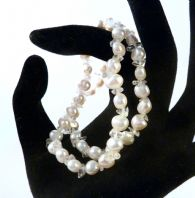 Two Pearl And Clear Quartz Stretch Bracelets.